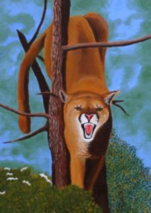 Cougar up in a tree
